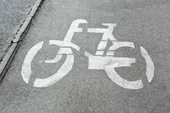 Bicycle lane road sign. On gray asphalt Stock Images
