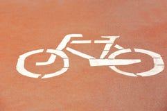 Bicycle lane road sign. On red asphalt Stock Image