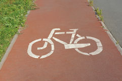 Bicycle lane road sign. On red asphalt Royalty Free Stock Photography
