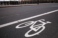 Bicycle lane on the roan in Paris, France. Bicycle lane sign on the roan in Paris, France royalty free stock images