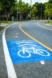 Bicycle lane and running lane in park for exercise and healthy. Royalty Free Stock Image