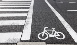 Bicycle lane sign across road sign. As background Royalty Free Stock Photos