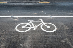 Bicycle Lane Sign on Asphalt Road Stock Image