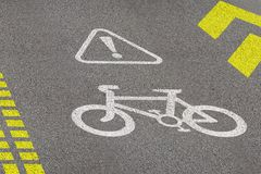 Bicycle lane sign on asphalt road. Concept of biking safety and active lifestyle. 3D perspective view at day time royalty free stock photo
