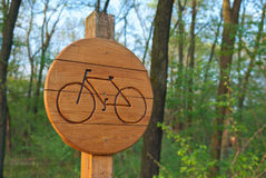 Bicycle lane sign indicating bike route wooden Royalty Free Stock Photography