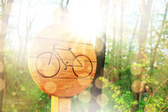 Bicycle lane sign indicating bike route wooden Royalty Free Stock Images