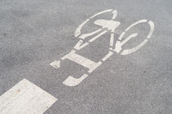 Bicycle Lane. Bicycle sign painted on the road in Poland Stock Photography