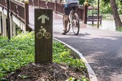 Bicycle lane sign in park Royalty Free Stock Images