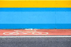 Bicycle lane with sign on red painted road Stock Photography