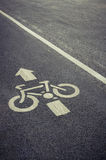 Bicycle lane sign on the road Royalty Free Stock Image