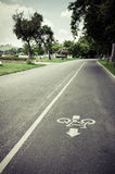 Bicycle lane sign on the road Stock Photos