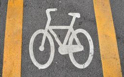 Bicycle lane sign on road Royalty Free Stock Photography