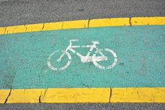 Bicycle lane sign on road Stock Photography