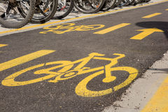 Bicycle lane sign on the road Stock Photography