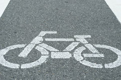 Bicycle lane sign, white chalk painted on street Royalty Free Stock Photography