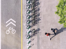 Bicycle Lane signage with bicycle parking on street People walking Urban city top view stock photos