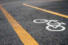 Bicycle lane signage on street Stock Images