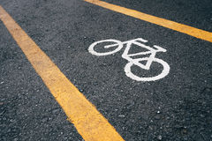 Bicycle lane signage on street Royalty Free Stock Photo