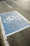 Bicycle lane symbol. On a paved highway Stock Images