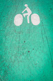 Bicycle lane symbol on the ground. Royalty Free Stock Image