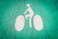 Bicycle lane symbol on the ground. Royalty Free Stock Images