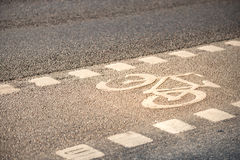 Bicycle lane symbol on the ground. Stock Photography