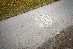 Bicycle lane symbol on the ground. Stock Photos
