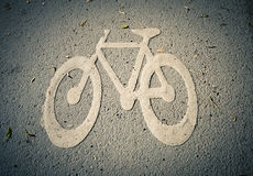 Bicycle lane symbol on the ground. Royalty Free Stock Photo