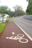 Bicycle lane on uphill&downhill street with sign, arrow and mar Stock Image
