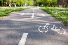 Bicycle lane with white bicycle sign Royalty Free Stock Photos