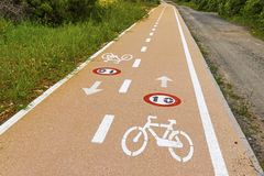 Bicycle lanes on Sardinia island, Italy. Bicycle lanes with roadsigns on the asphalt. Sardinia island, Italy royalty free stock photography