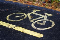 Bicycle lanes sign in park. Outdoor object stock photography