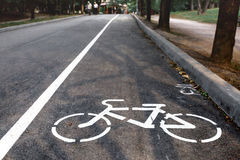 Bicycle Lanes Sign In Park. Bicycle lane sign on the road, symbol for roadway part reserved for cyclist only stock photography