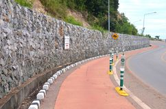 Bicycle lanes stick with the beach. Bicycle lanes stick with the beach and a stone wall along the line royalty free stock images