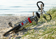 Bicycle laying at the beach Stock Photos