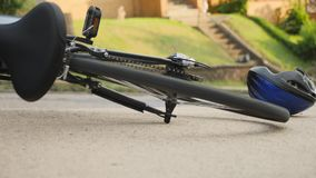 Bicycle Accident Scene Background. A bicycle lays on the sidewalk with the wheels spinning after an accident as traffic passes by stock footage