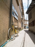 Bicycle lean on a wall Stock Images