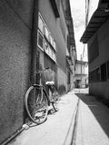 Bicycle lean on a wall in street of old town Stock Photography