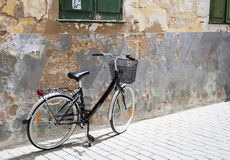 Bicycle. Leaning against an old wall royalty free stock photo