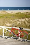 Bicycle leaning against rail royalty free stock photos