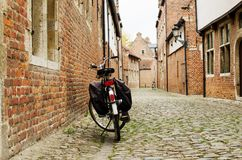 Bicycle leaning against the wall in Begijnhof Leuven Stock Photos