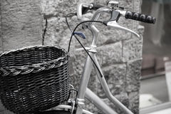 Bicycle leaning against the wall Stock Photography