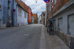 Bicycle Leaning on Black Metal Post Stock Photo