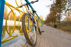 Bicycle leaning on colorful iron railings Stock Photos