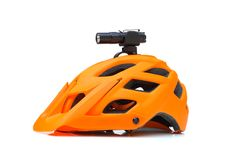 Bicycle LED torch for night riding. Installed on a mountain bike helmet isolated royalty free stock photography