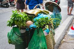 Bicycle loaded with groceries and gum boots on top. Vietnam stre Stock Images