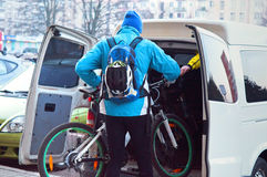 Bicycle, loading, travel, van, load, transport. To load the bike in the van, traveling by car and by bike Stock Image