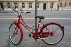 A BICYCLE LOCKED TO A LAMP POST Royalty Free Stock Photo