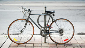 A bicycle locked up on the street Royalty Free Stock Photos