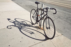 Bicycle locked up on the street in Toronto Royalty Free Stock Photos